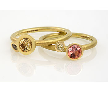 Rings in 18ct yellow gold set with natural coloured sapphires and diamonds