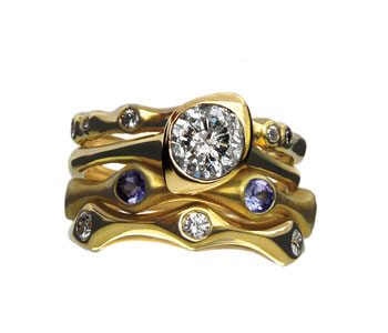Stacking rings in 18ct gold set with diamonds and tanzanites