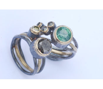Rings in 18ct gold and silver set with precious stones