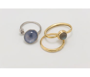 Rings in 18ct Gold and platinum and set with star sapphire and labradorite.