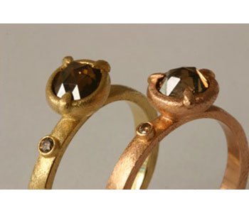 Claw rings in 18ct yellow and rose gold with diamonds