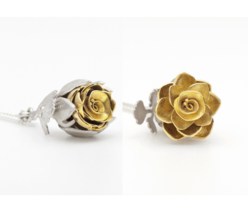 Kinetic Rose locket in silver and18ct gold with diamond