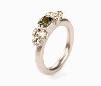 'Seven Bud' ring in 18ct white gold set with pale yellow and green sapphires
