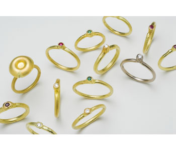 'Fused' rings in 18ct yellow and white gold set with precious and semi-precious stones