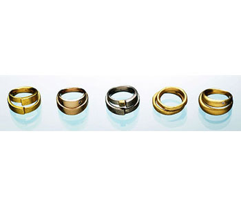 'Lovers Rings' group of rings in 18ct white and yellow gold some set with diamonds