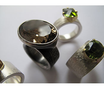 Rings in etched silver set with tourmaline and smoky quartz