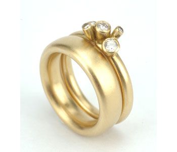 18ct gold and diamond bud rings