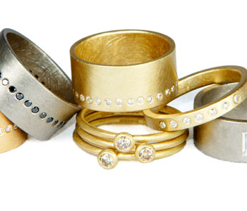 Group of diamond rings in 18ct yellow and white gold set with black, cognac and white diamonds