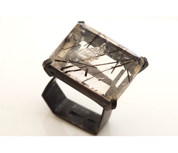 Ring in oxidised silver set with a tourmalinated quartz