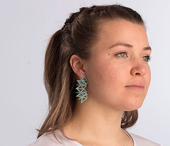 Laser cut earrings modelled
